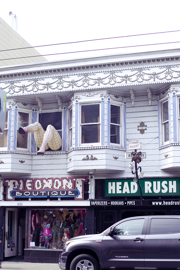 Giant legs on display in the window of a shop on Haight in San Francisco.
