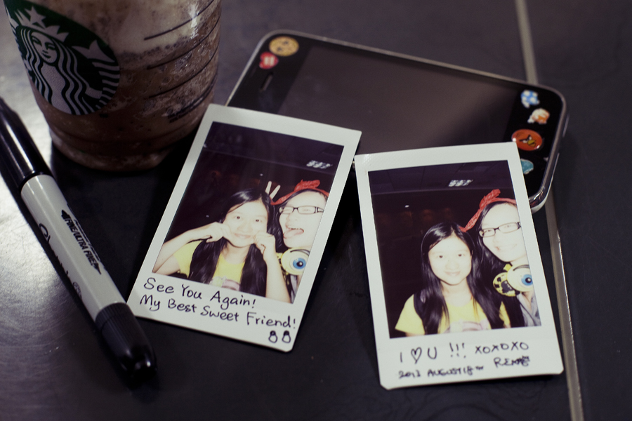 Instax photos of Zen and Ren at LAX.