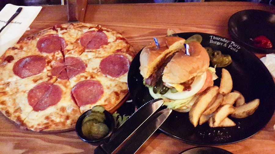 Salami pizza and burger at Burger & Pasta in Busan, South Korea.