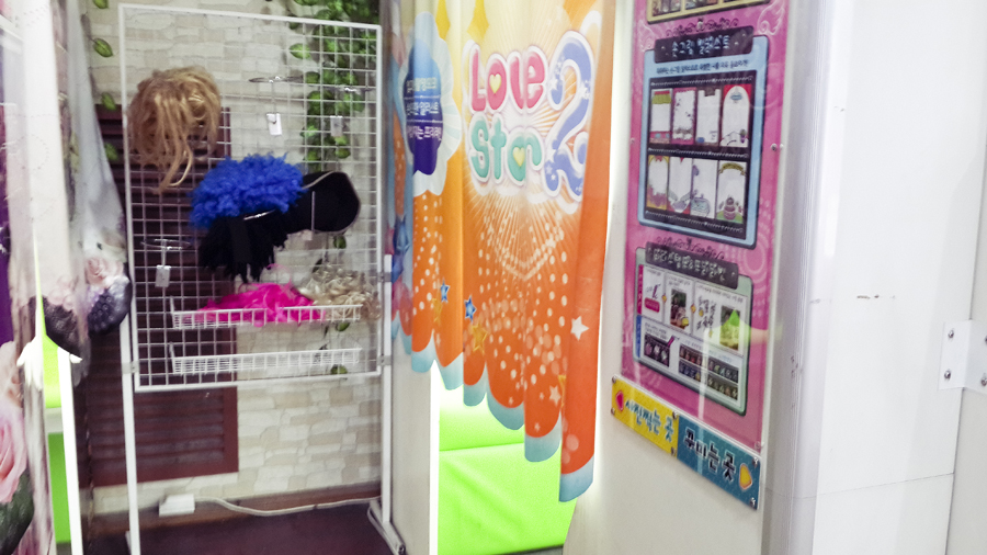 Props and wigs for purikura booths in Busan, South Korea.