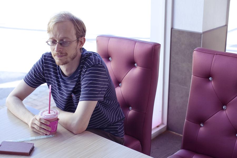 Ottie nursing his strawberry drink at Baskin Robbins in Sangju, South Korea.