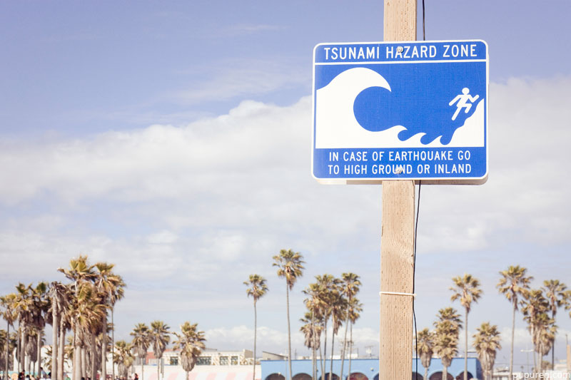 Tsunami hazard sign at Venice beach, Los Angeles.