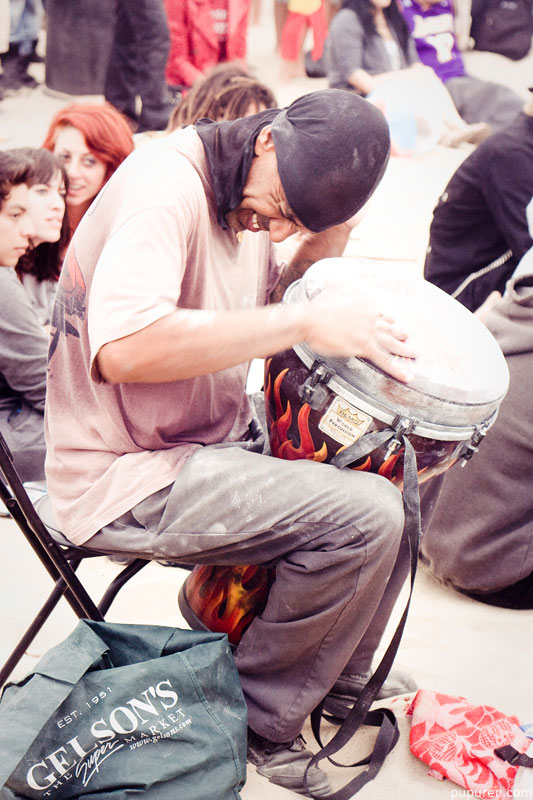 Drummer in a drum circle at Venice beach, Los Angeles.