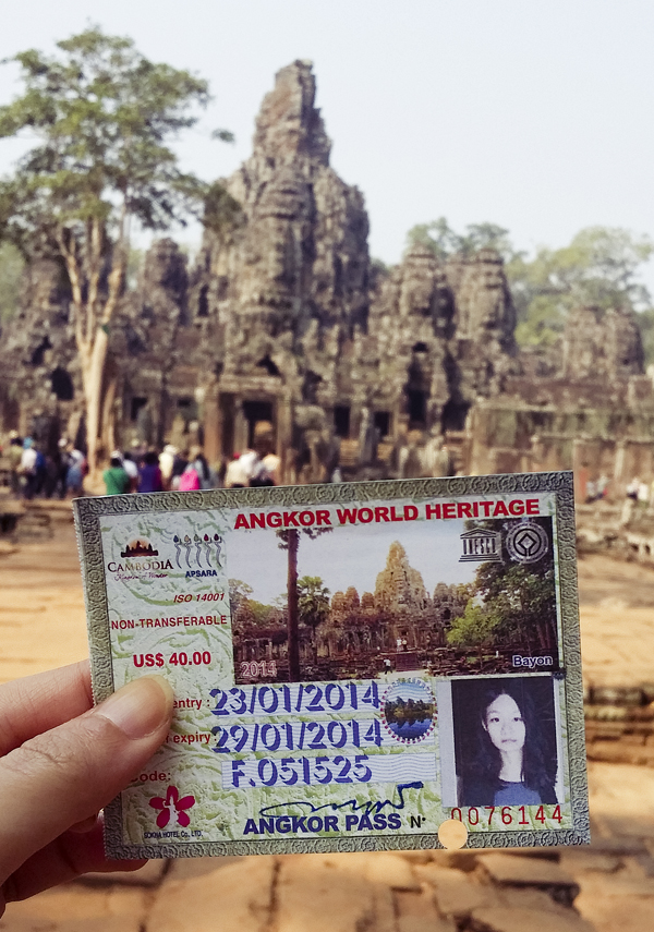 Holding my Angkor World Heritage three day entry pass in front of Bayon in Angkor Thom, Cambodia.