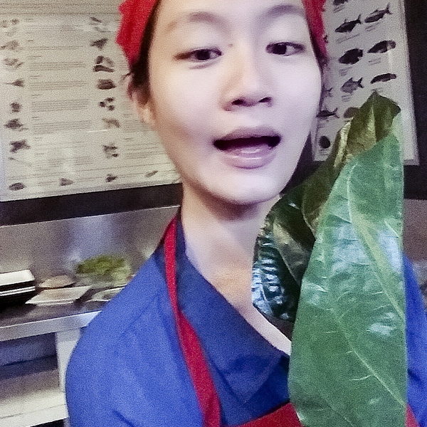 Ren holding a leaf at the cooking class at Le Tigre de Papier in Pub Street, Siem Reap, Cambodia.