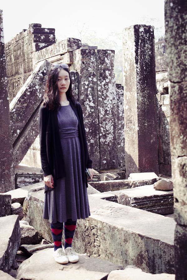 Ren standing among ruins at Bayon in Angkor Thom, Cambodia.