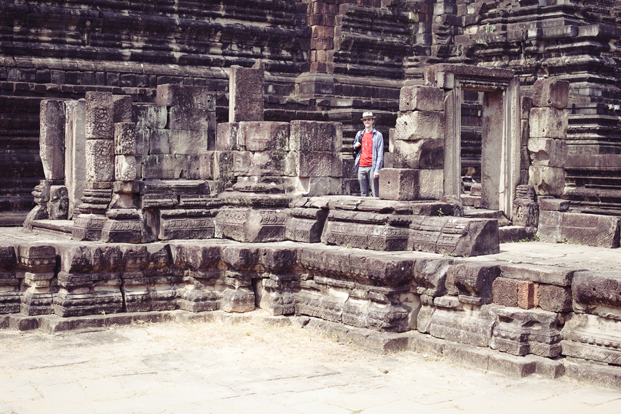 Ottie among the ruins of Baphuon in Angkor Thom, Cambodia.