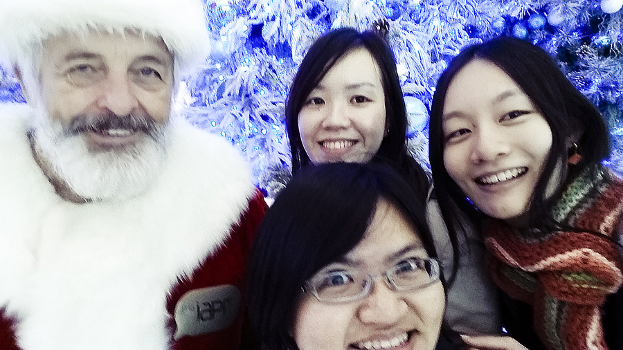Taking a photo with Santa Claus in a shopping mall along Nanjing Road in Shanghai.