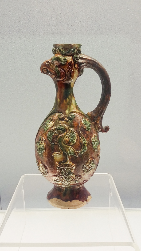 Polychrome glazed pottery ewer with a phoenix head from the Tang Dynasty (618-907 AD) at the Shanghai Museum.