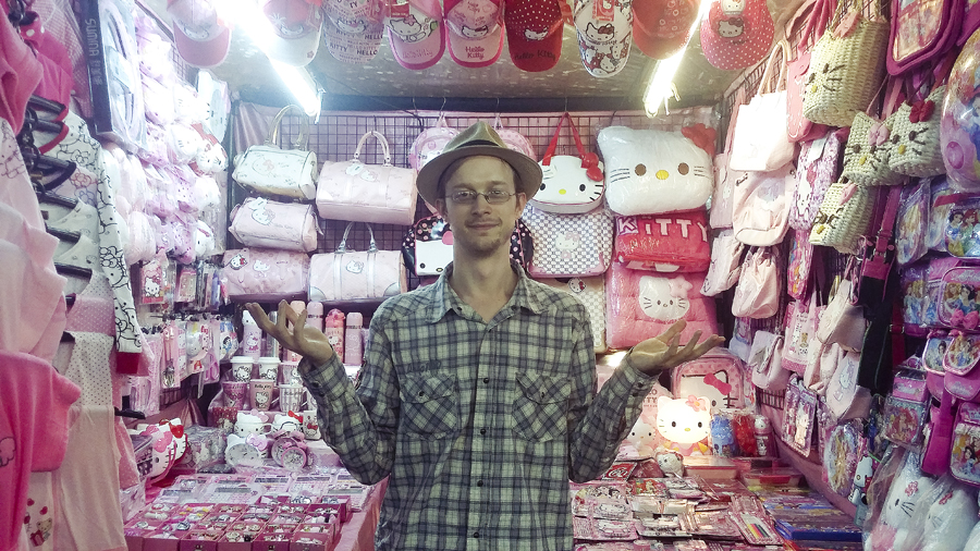 Ottie in front of a Hello Kitty stall in Patpong Night Market in Bangkok, Thailand.