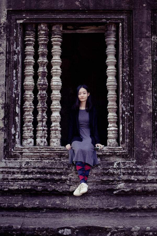 Ren sitting on a window at Angkor Wat, Cambodia.