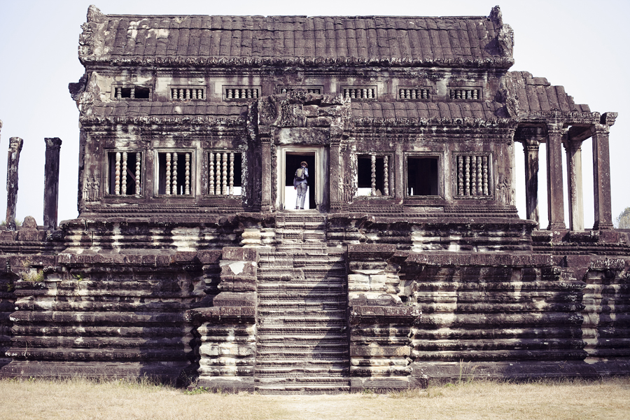Ottie scaling a portion of Angkor Wat, Cambodia.