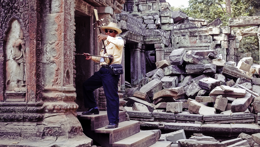 Mr. Meng playing the erhu at Ta Prohm, Cambodia.