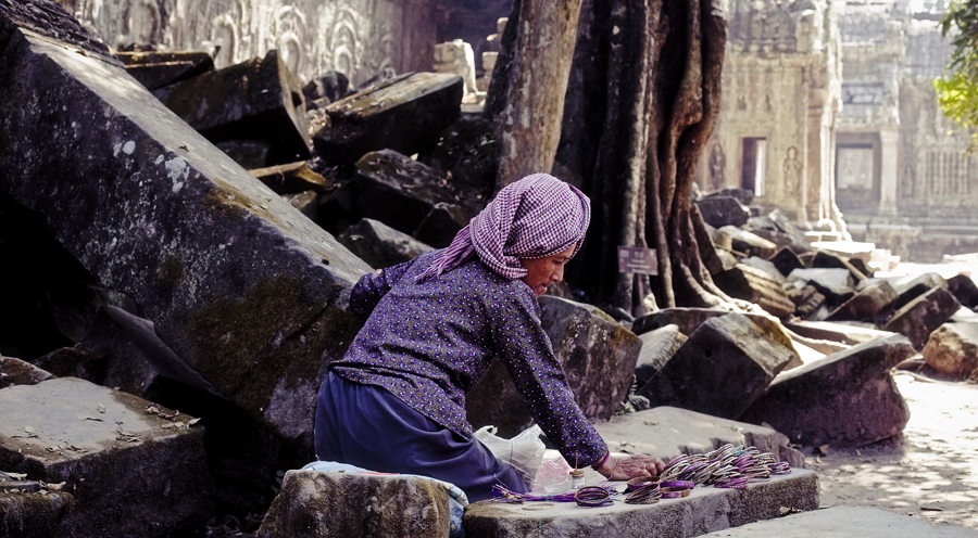 Woman selling woven jewelry at Ta Prohm, Cambodia.