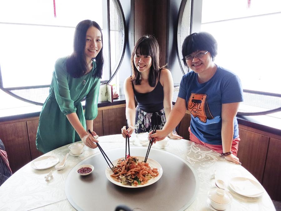 Ren, Ade, and Puey with lohei at Tian Fu Tea Room by Si Chuan Dou Hua in Singapore.