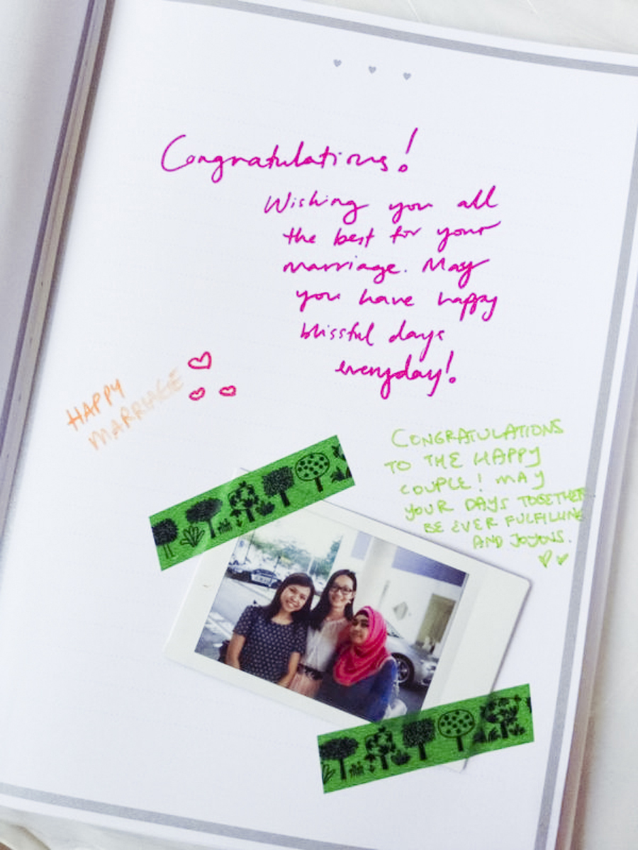 Instax photo of Ruru, Ren, and Sal next to congratulatory messages on the guestbook of Azi & Darwis' wedding. Photo by Ruru.