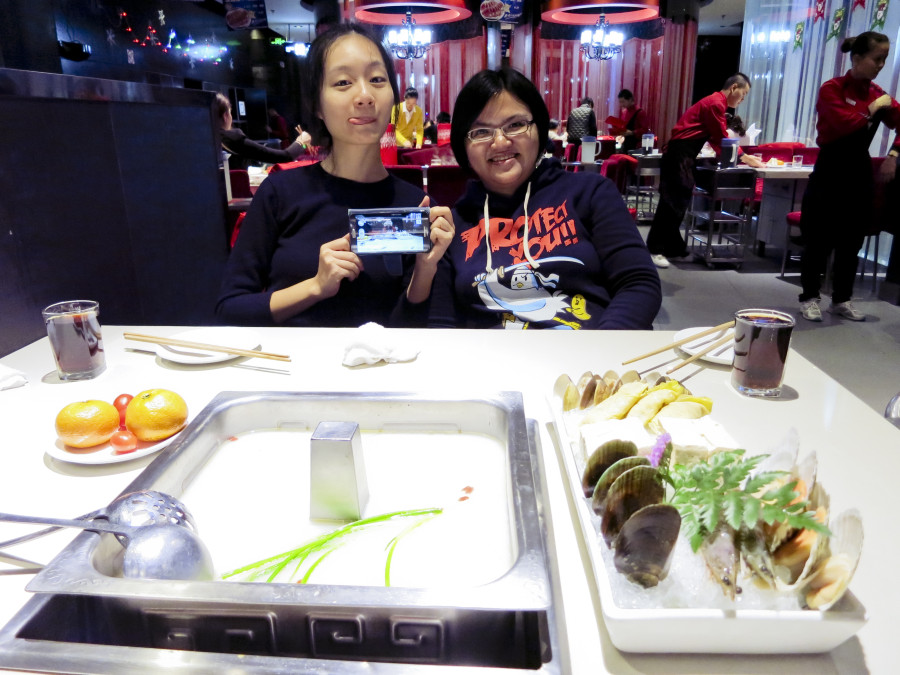 Ren and Puey at Hai Di Lao Hotpot Restaurant in Shanghai.