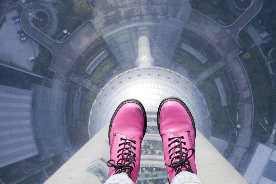 Standing on the glass floor of the Oriental Pearl tower, Shanghai.