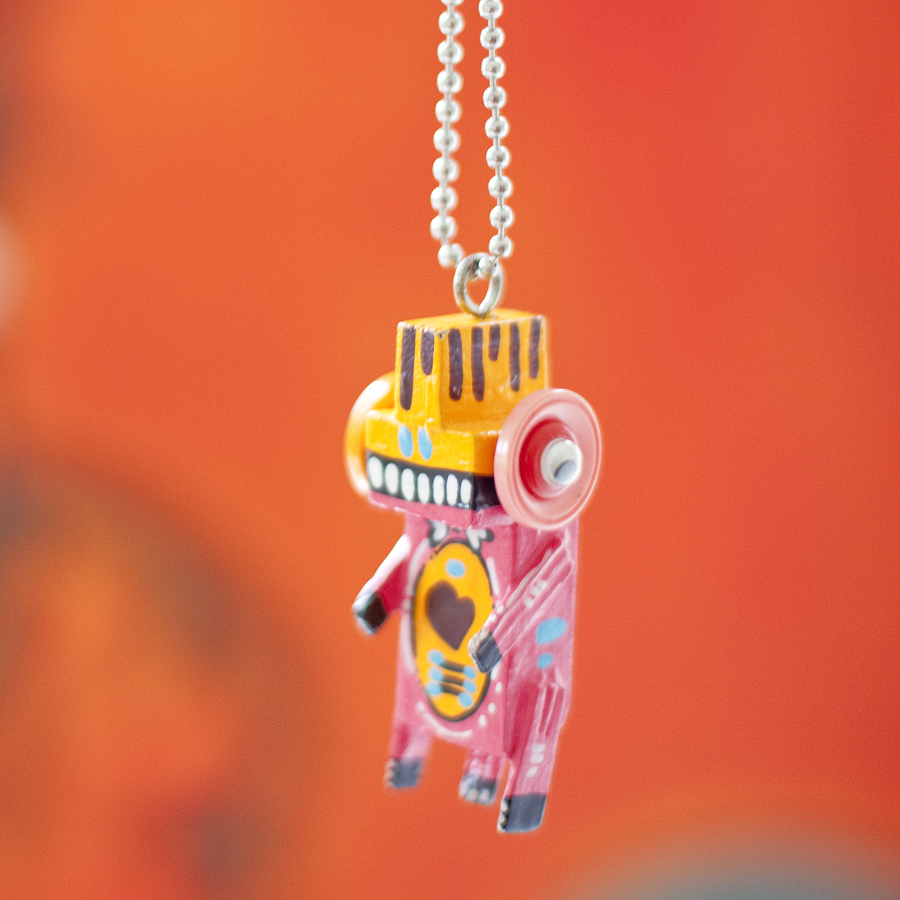 Pink voodoo doll necklace from Takashimaya.