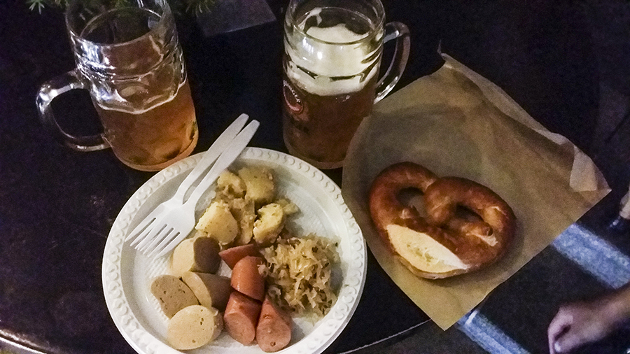 Plate of Bavarian Sausage, a pretzel, and two Erdinger beers at the Oktoberfest The Beer Garden at the Fullerton Hotel.