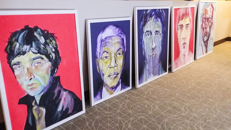 Painted portraits at the Bank Art Fair 2014 in Singapore.