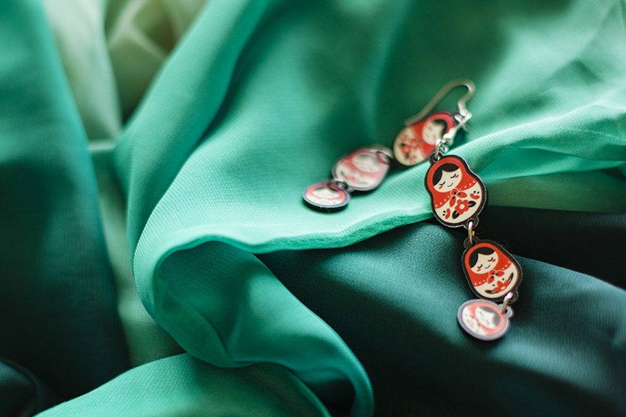 red matryoshka earrings against green chiffon shirt from Romwe.