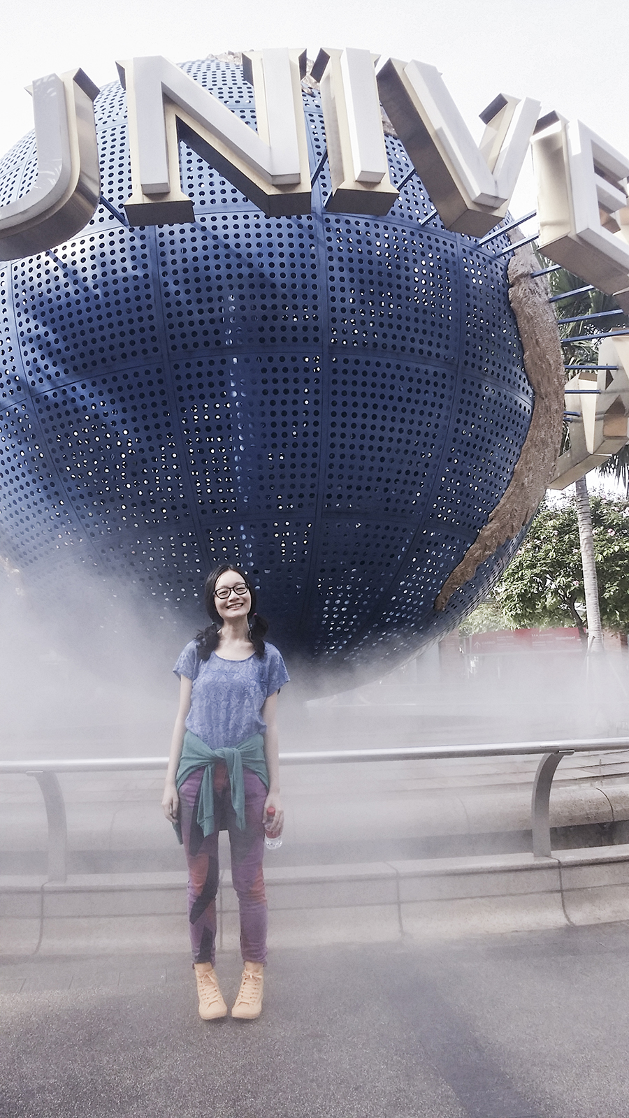Posing in front of the globe at Universal Studios Singapore.