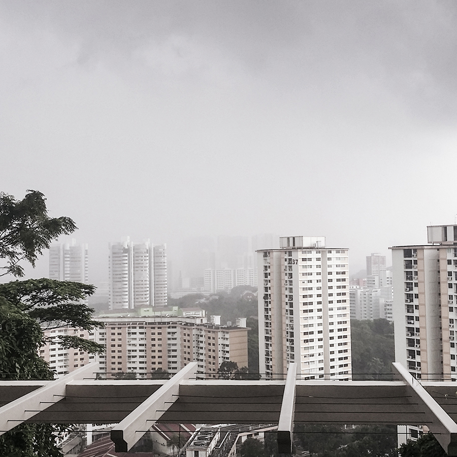 View of a downpour in the distance from the Southern Ridges Trail in Singapore.