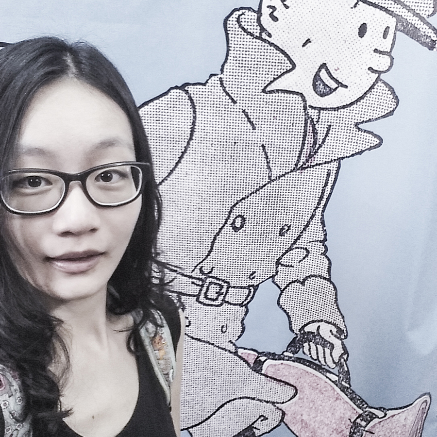 Selfie with a wall banner outside The Tintin Shop in Chinatown, Singapore.