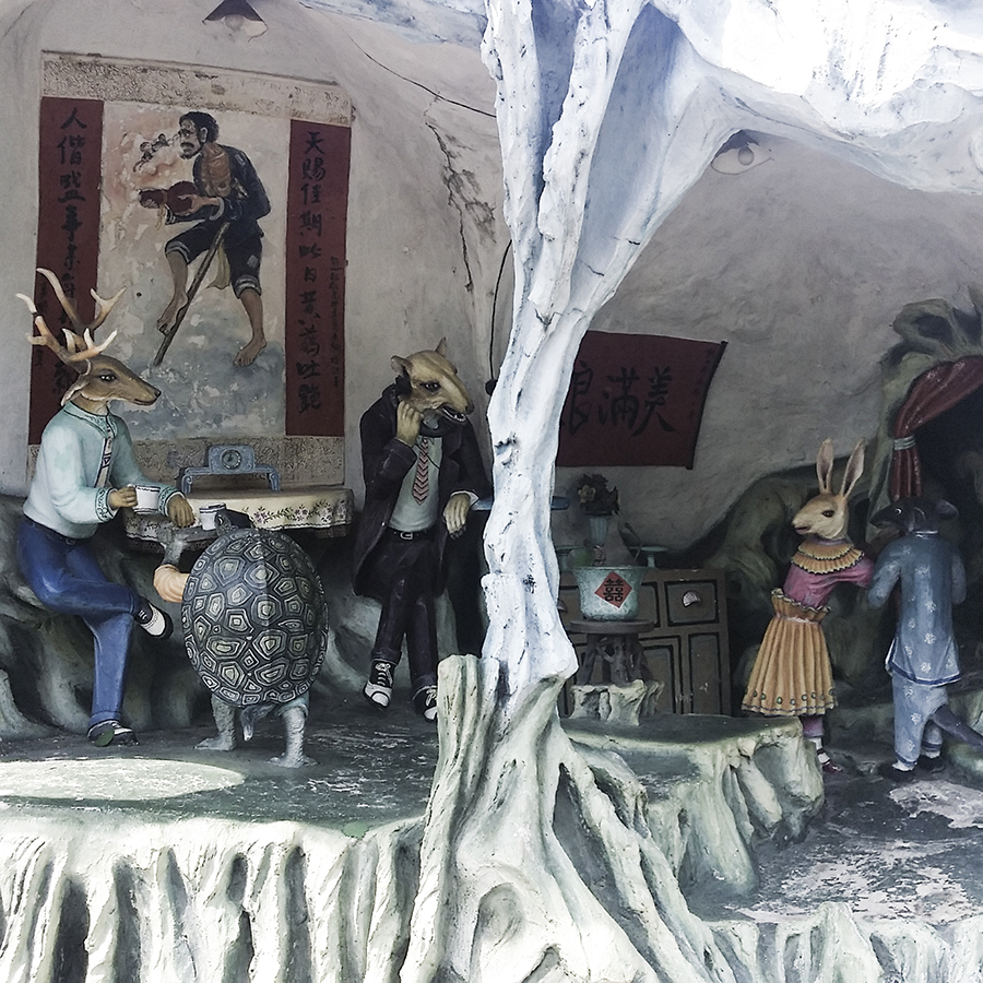 Diorama of anthropomorphic animals in a house at Haw Par Villa, Singapore.