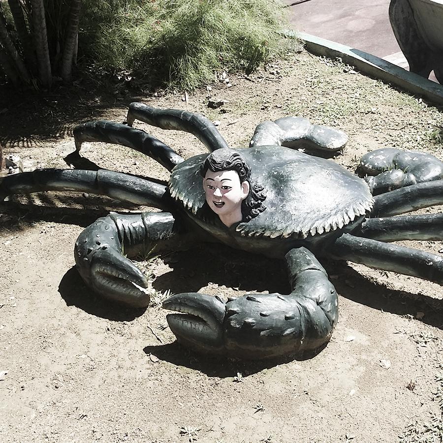 Weird human head on a giant crab's body at Haw Par Villa, Singapore.