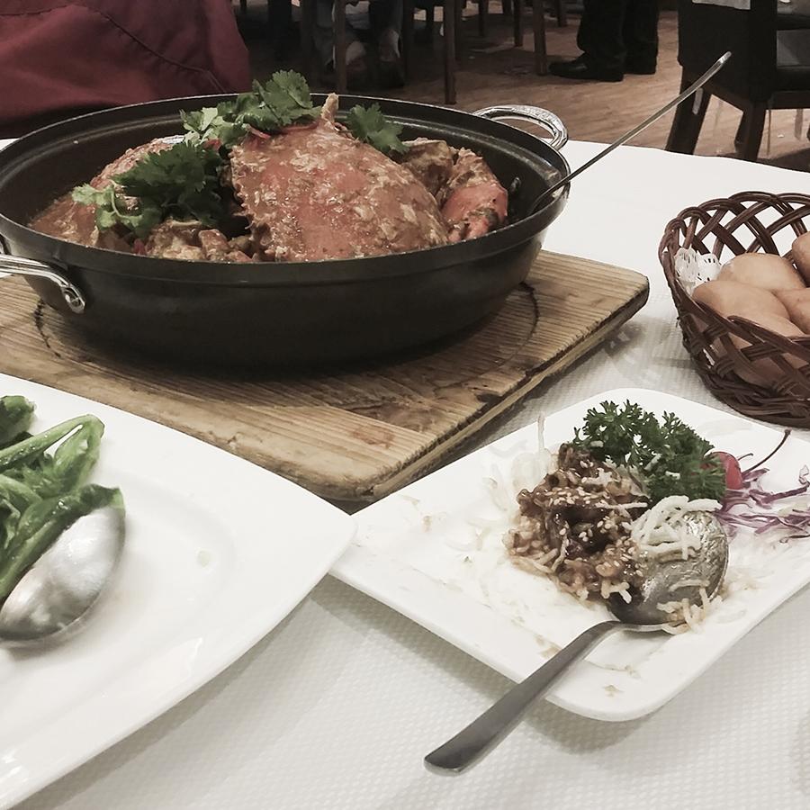 Chilli crab, kai lan vegetables, mantou, and fried baby squid at Jumbo Seafood Restaurant at The Riverwalk, Singapore.