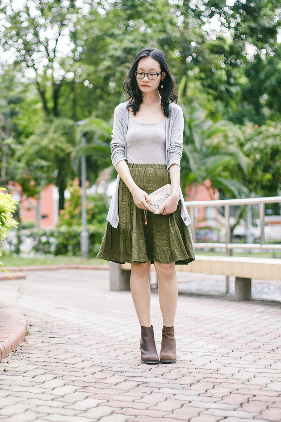 Outfit: EMart grey bratop, Bugis Street green skirt, Gap black frame glasses, Jeffrey Campbell Cash brown heel boots via Chictopia Shop, Happy Memorial Sky embroidered pouch from Takashimaya.