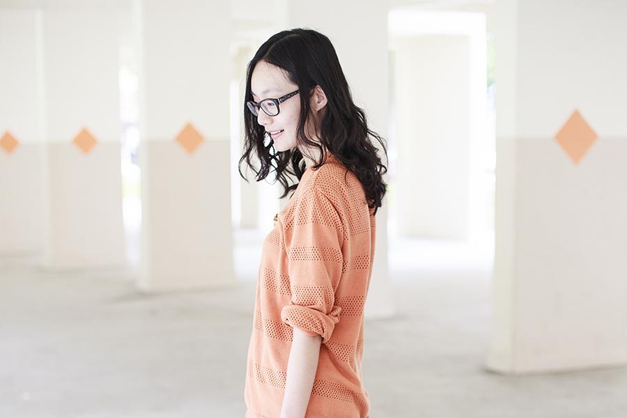 Making a face in Gap black frame glasses, Forever 21 orange oversized boyfriend cardigan, vintage gold rose brooch.