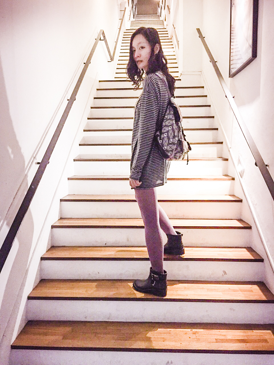 Outfit photo: Zara striped top, purple plaid tights, Dav black rubber rain booties, T-Shirt & Jeans tribal print backpack. Photo by Ruru.