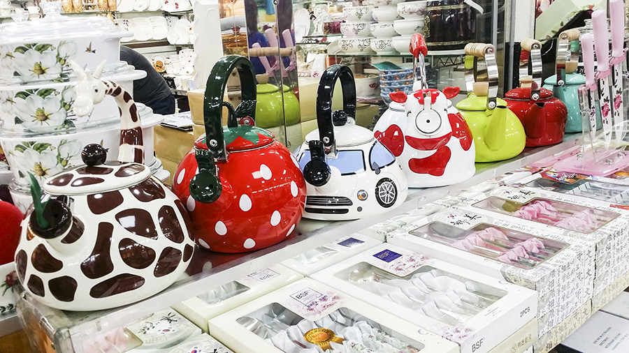 Cute painted water kettles on display at Dongdaemun market, Seoul, South Korea.