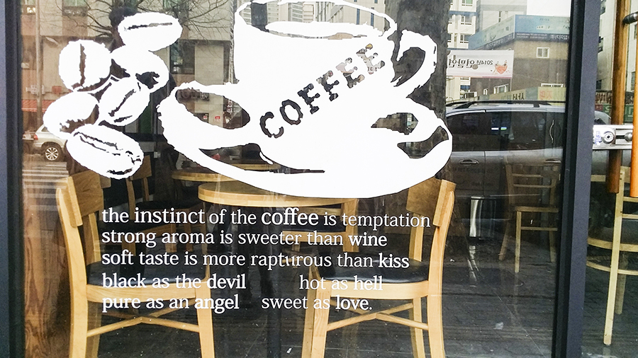 Quote outside a cafe about coffee in Seoul, South Korea.