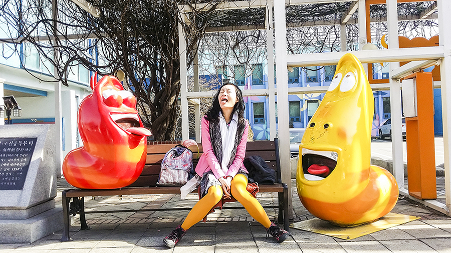 Posing with Red and Yellow sculptures at Seoul Animation Center, South Korea.