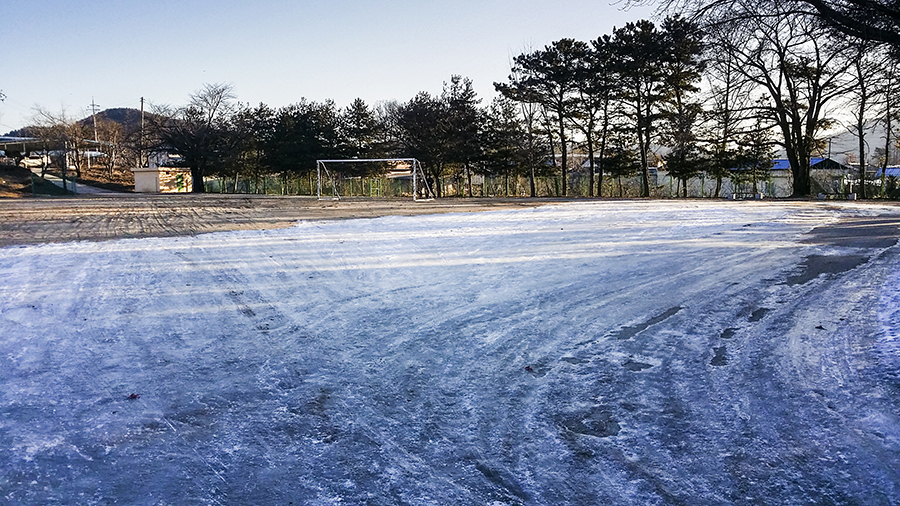 Ice-covered field at the mountainside school.