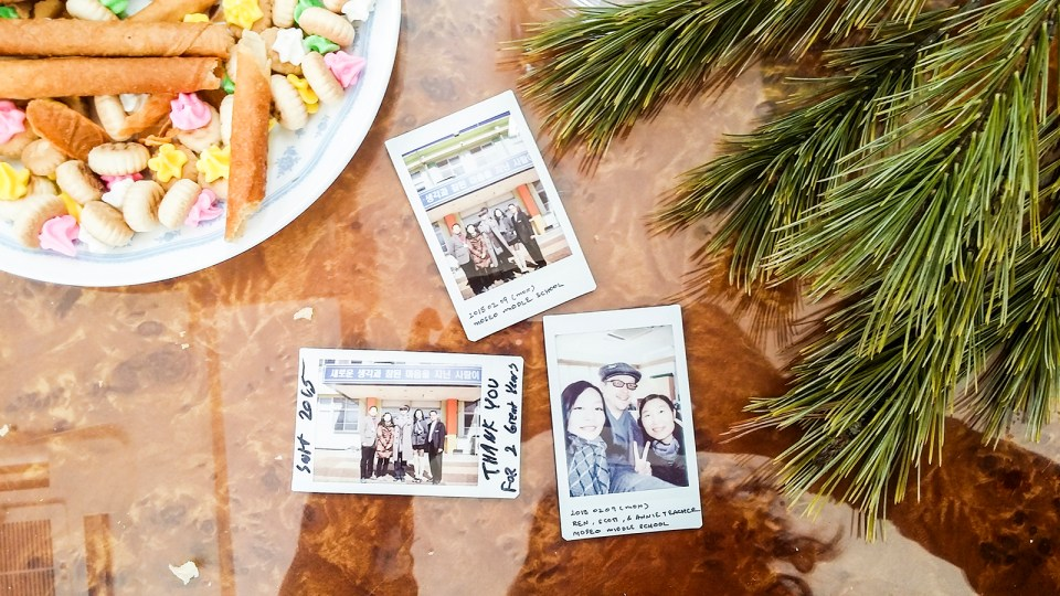 Fujifilm Instax photos with faculty of mountainside middle school against snacks from Singapore.