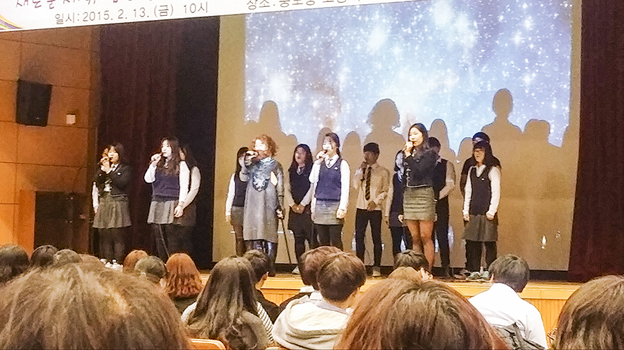High school second graders singing after a skit to bid farewell to the 3rd graders during graduation  in Sangju.