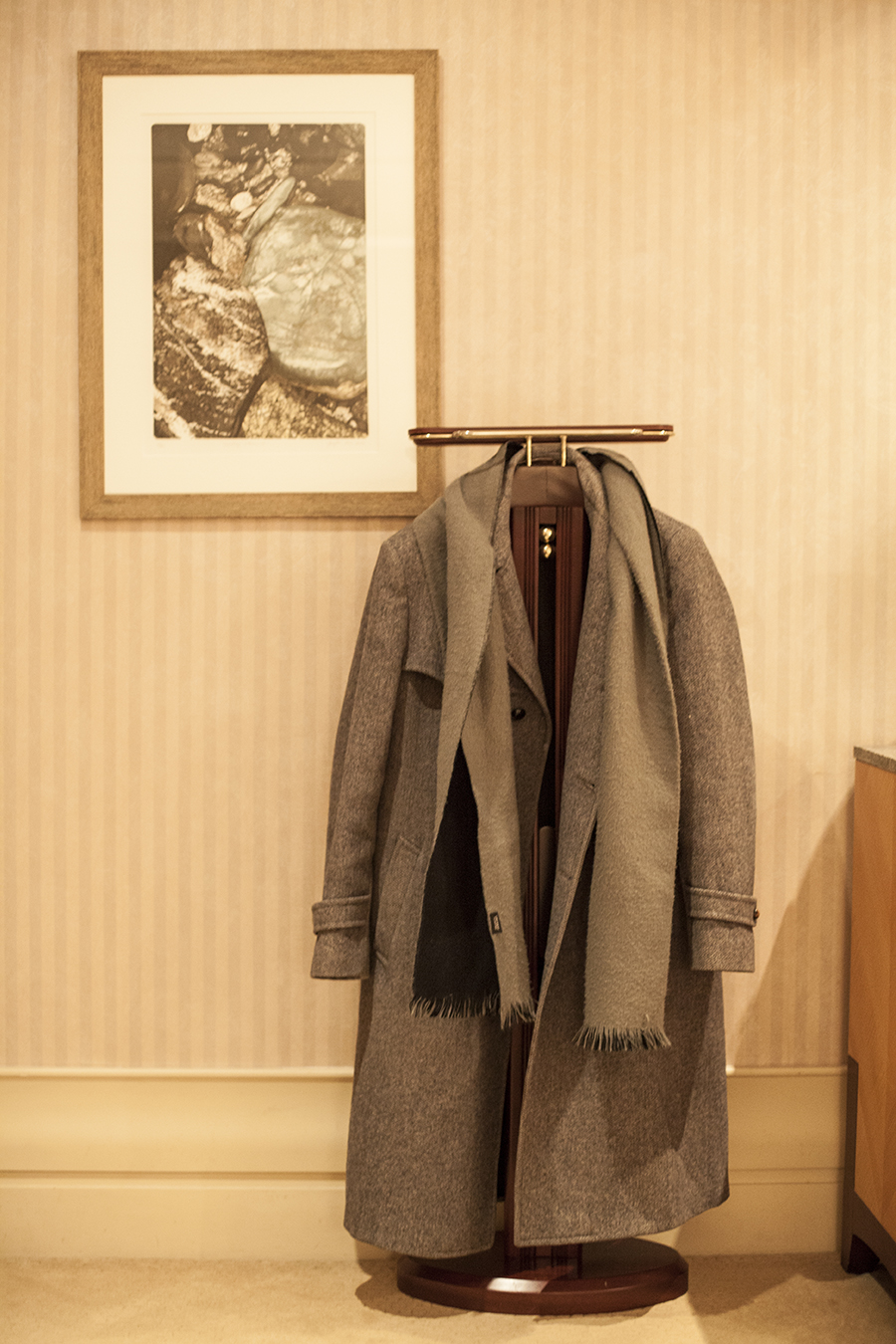 Coat hanging on a coat stand at the Lotte Hotel, Myeongdong, Korea