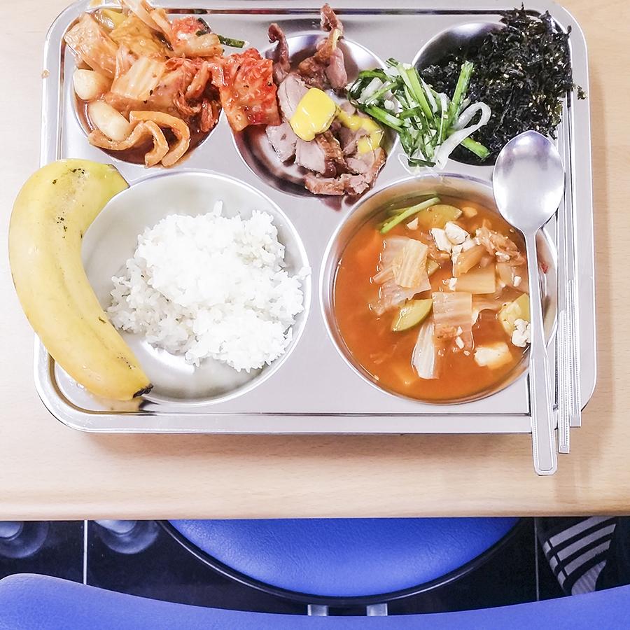 School lunch of kimchi, pork, seaweed / laver in Sangju, South Korea.