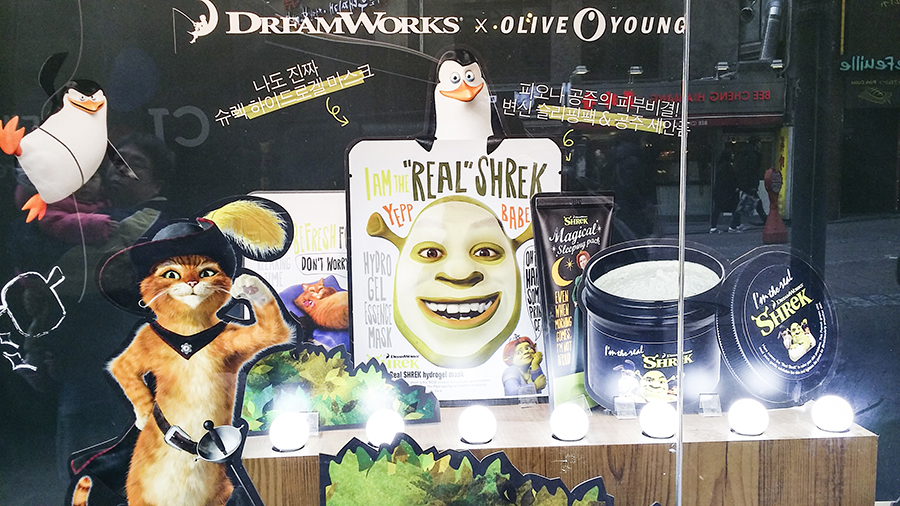 Window display featuring a collaboration between Dreamworks Shrek characters and facial masks from Olive Young in Myeongdong, Seoul, South Korea.