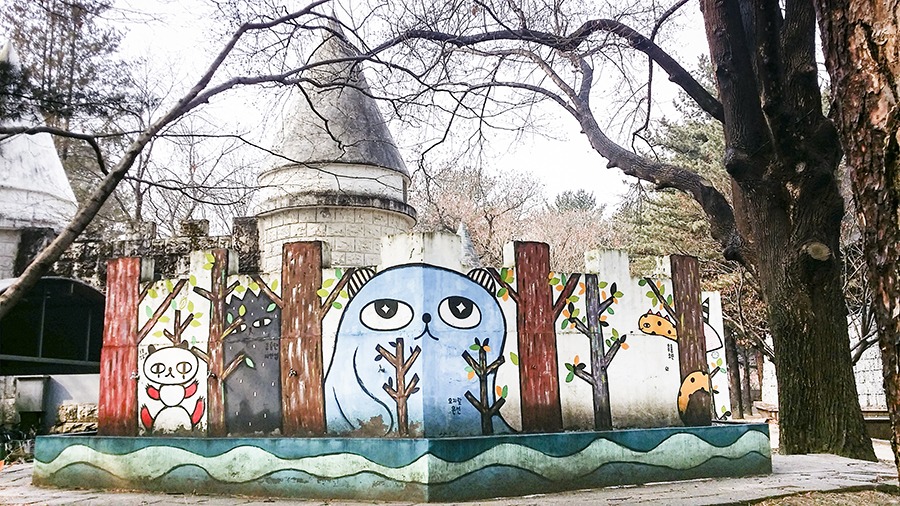 Cute characters on the walls of a castle structure at Nami Island, Gapyeong, South Korea.