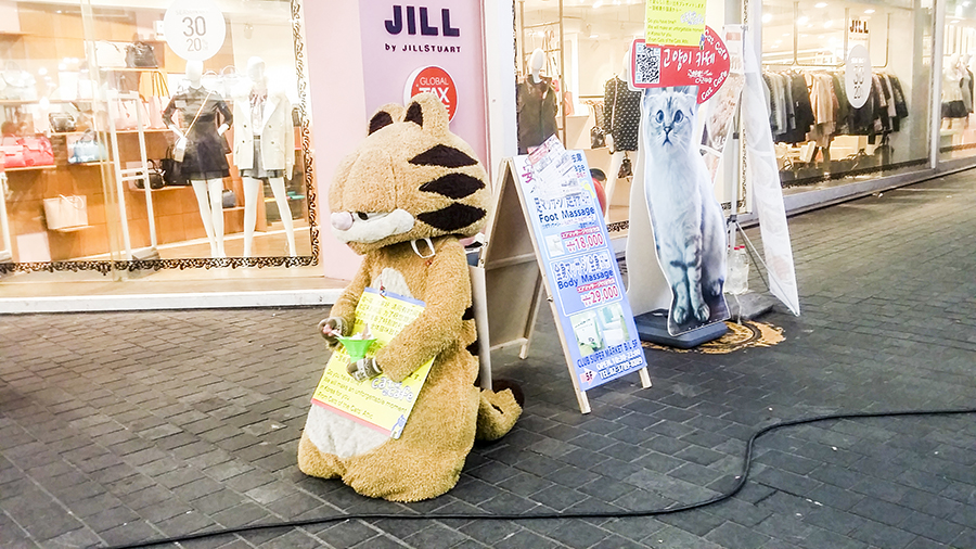 Garfield cat mascot on the streets of Myeongdong advertising for Godabang Cat Cafe in Seoul, South Korea.