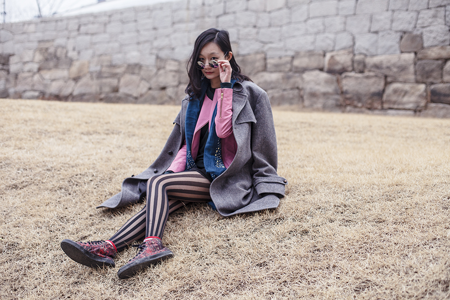 Outfit at Dongdaemun Design Plaza: Viparo pink lambskin leather jacket, H&M green merino wool sweater, H&M Divided black chiffon dress, Nordstrom black striped tights, Taobao mirror circle sunglasses, Alexander McQueen x Puma high top sneakers. Photo taken by Ottie.