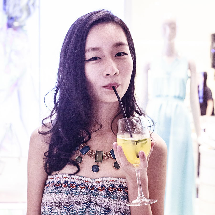 Sipping on a pineapple mocktail at the Nine West SS15 Collection launch preview at Suntec, Singapore.