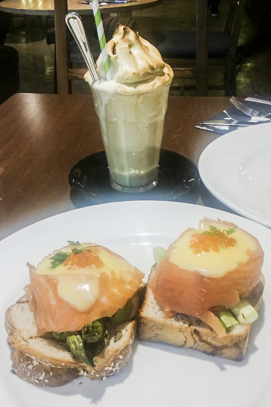 Norwegian breakfast with eggs benedict wrapped in salmon and asparagus, Banana shake at Wild Honey, Singapore.