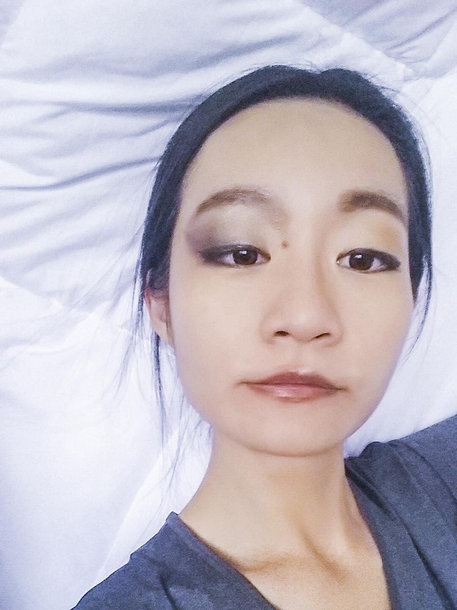 Half-face makeup.
